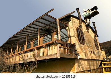 House with Wooden Balcony Topped with Asian Style Dragon Head