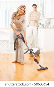 House work, vacuum cleaner, young couple, home, kitchen. Housework