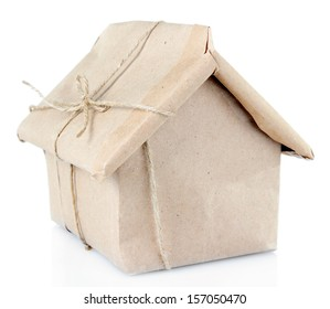 House wrapped in brown kraft paper, isolated on white