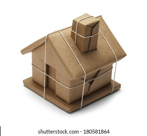 House Wrapped up In Brown Paper And Rope Isolated on White Background.