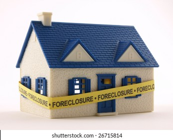 House wrapped with Foreclosure tape front view
