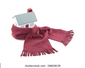 House wrapped in a scarf isolated on white