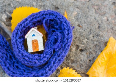 house is wrapped in a scarf. Warm house concept