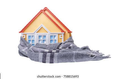 House is wrapped up in a winter scarf standing on a white knitted plaid.