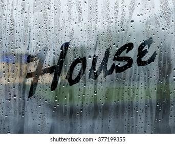 House written on a foggy window