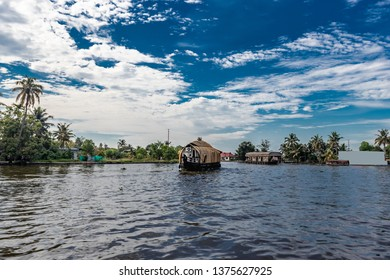 Houseboat image with blue sky and cloud at alleppey kerala india.
