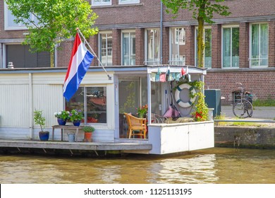 Houseboat on a canal in Amsterdam