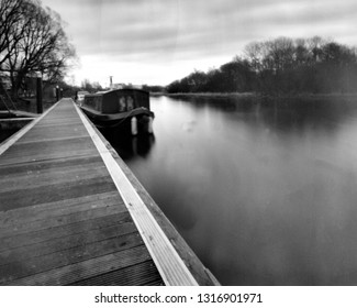 houseboat on the river erne, enniskillen, fermanagh, northern ireland, this black and white photo is NOT sharp due to camera characteristic, taken on analogue photographic film with a pinhole camera
