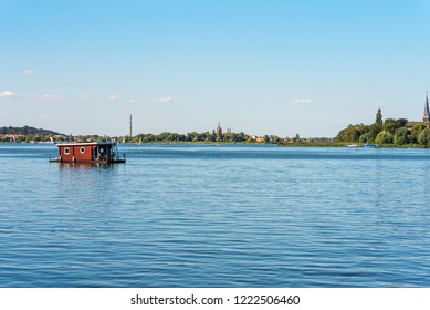 Houseboat on the river Havel southerly from Berlin. The river forms several lakes in the state of Brandenburg, Germany