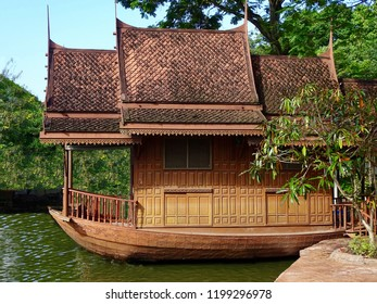 Houseboat on water. Traditional Houseboat in Asia, Thailand.