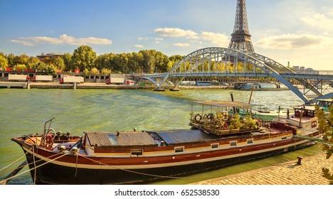 Houseboat in Paris. Houseboat on the Seine river. Eiffel tower.