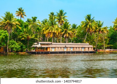 A houseboat sailing in Alappuzha backwaters in Kerala state in India