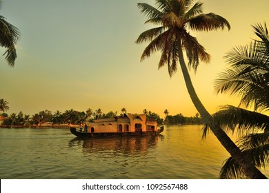 A houseboat sailing in kerala backwaters during sunset.