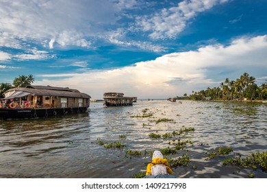 Houseboats in backwater with blue sky and white clouds image is taken at alleppey kerala india. It is showing the amazing beauty of alleppey.