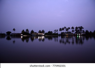 Houseboats at dawn in Vembanad Lake in Alappuzha (Alleppey), Kerala, India
