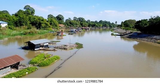 Houseboats and floating plant farming fields in countryside river, Local argriculture life,Uthai Thani,Thailand.