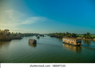 Houseboats sailing on the backwaters of Alleppey early morning