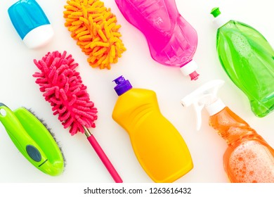 Housecleaner tools set with detergents, soap, cleaners and brush on white background top view mock up