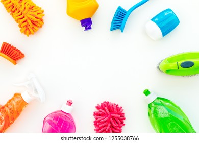 Housecleaning with detergents, soap, cleaners and brush in plastic bottles on white background top view mockup