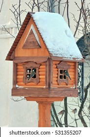 House-feeder for small birds and two titmice in Tolga monastery in Yaroslavl, Russia