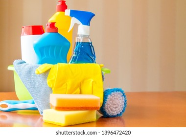 Household chemicals stacked in a green bucket