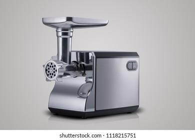 household electric meat grinder on light grey background. kitchen appliances