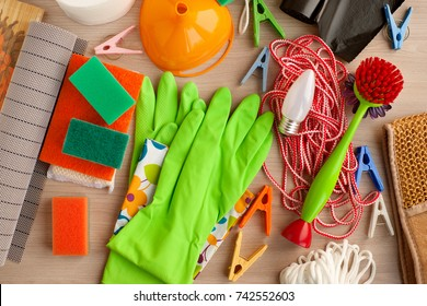 Household goods. View from above. Rubber gloves, clothesline, sponges, clothespins, electric lamp are household utensils. Household items for everyday life.