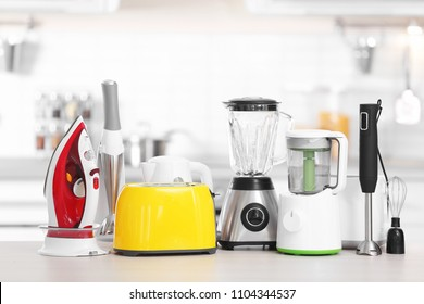 Household and kitchen appliances on table indoors. Interior element