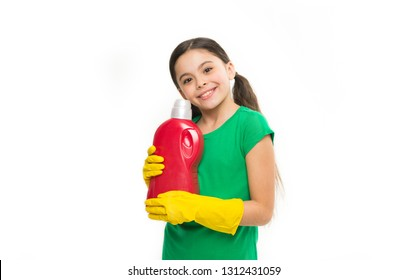 Household laundering. Little child ready for doing laundry. Small housekeeper holding detergent bottle in hands. Cute household helper wearing yellow rubber gloves. Using household cleaning product.