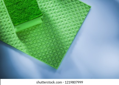 Household washcloth sponge on white surface.