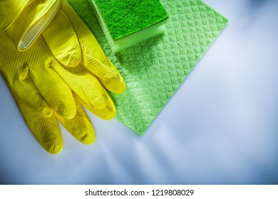 Household washcloth sponge protective gloves on white surface.