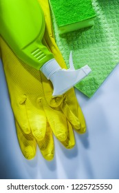 Household washcloth sponge sprayer protective gloves on white background.