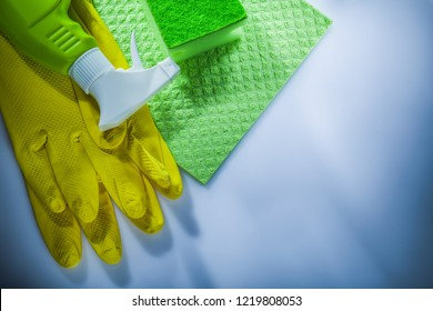 Household washcloth sponge sprayer safety gloves on white background.