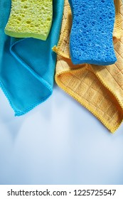Household washcloth sponges on white surface.