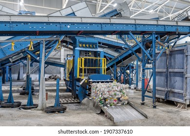 Household waste sorting and recycling plant. Press for pressing plastic bottles.