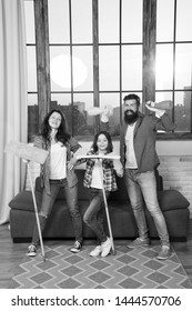 Householding team. Preparing For Life. Family clean house. Happy family hold cleaning products. Mother, father and daughter clean house. Householding. Householding people. Householding chemicals.