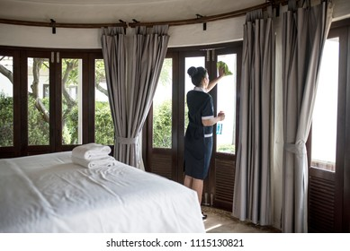 Housekeeper cleaning a hotel window