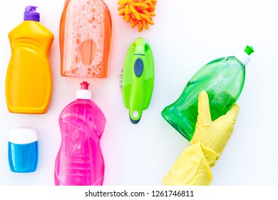 Housekeeping tool. Detergents, soap, cleaners and brush for housecleaner work on white background top view space for text