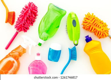 Housekeeping tool. Detergents, soap, cleaners and brush for housecleaner work on wooden background top view space for text