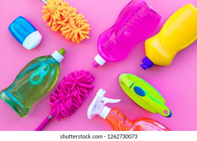 Housekeeping tool. Detergents, soap, cleaners and brush for housecleaner work on pink background top view space for text