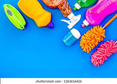 Housekeeping tool. Detergents, soap, cleaners and brush for housecleaner work on blue background top view space for text