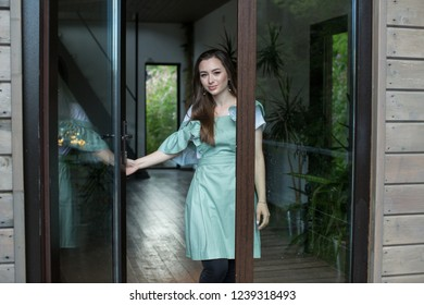 housemaid in the background of the house