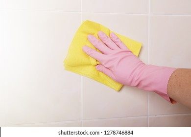 Housemaid cleaning a bathroom, closeup shot