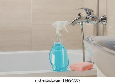 Housemaid cleaning a bathroom, closeup shot