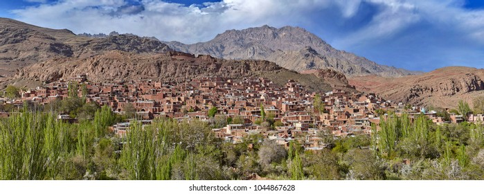Houses in Abyaneh red village is built of red mud brick by surrounding mountain terrain, Iran.