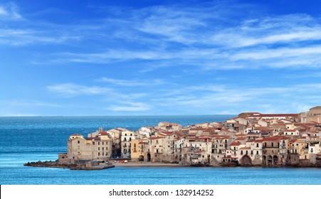 Houses along the shoreline in Cefalu, Sicily