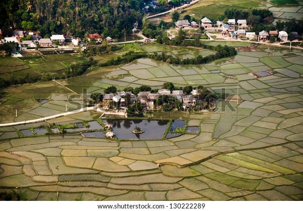 Houses among field in water season in Hoa binh province, Vietnam