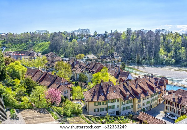 Houses at bank of Swiss alpine Aare river in Bern, capital city of Switzerland.