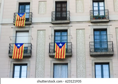 Houses of Barcelona city with flags of Catalonia