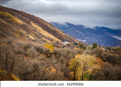 Houses at the Base of a Mountain with Dark Sky and Foliage- Ogden, Utah.